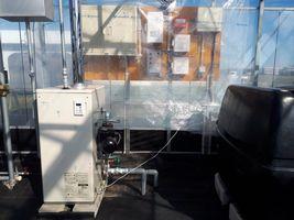 【写真】いちごハウス内に設置した温湯管のボイラー